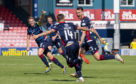 Ross County's Joe Chalmers celebrates scoring against Hamilton last month.