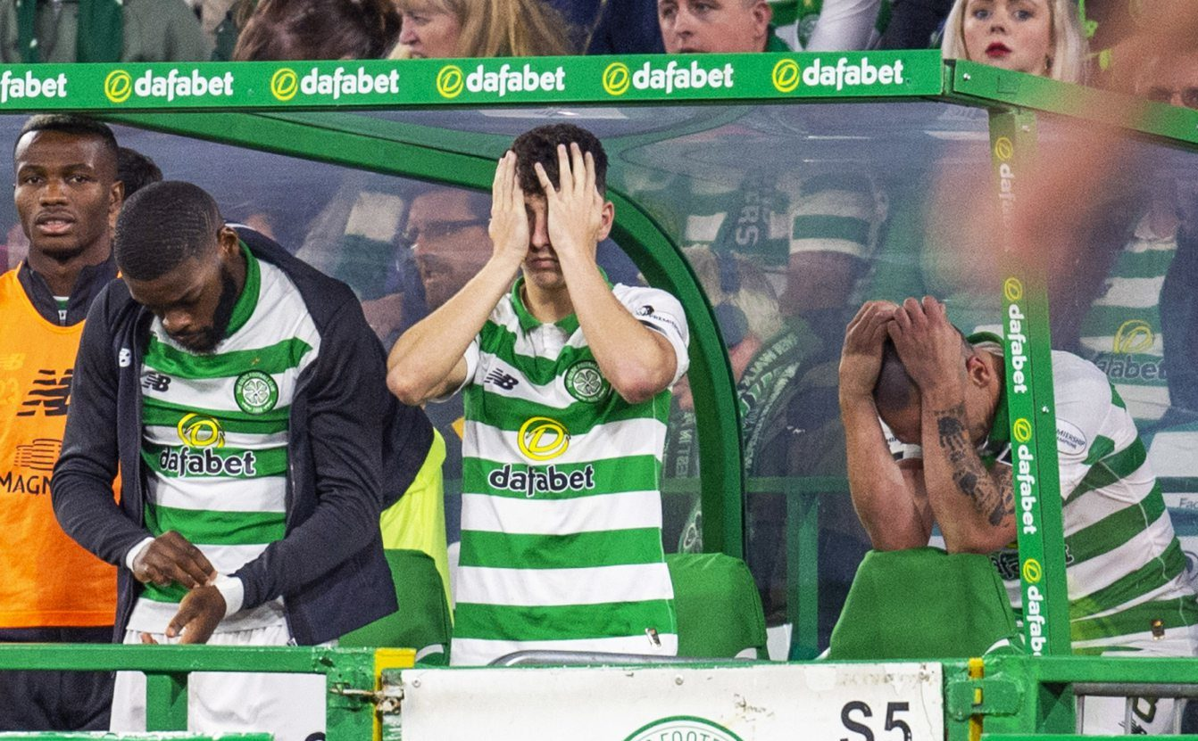 (L-R) Celtic's Olivier Ntcham, Mickey Johnston and Scott Brown looking dejected.