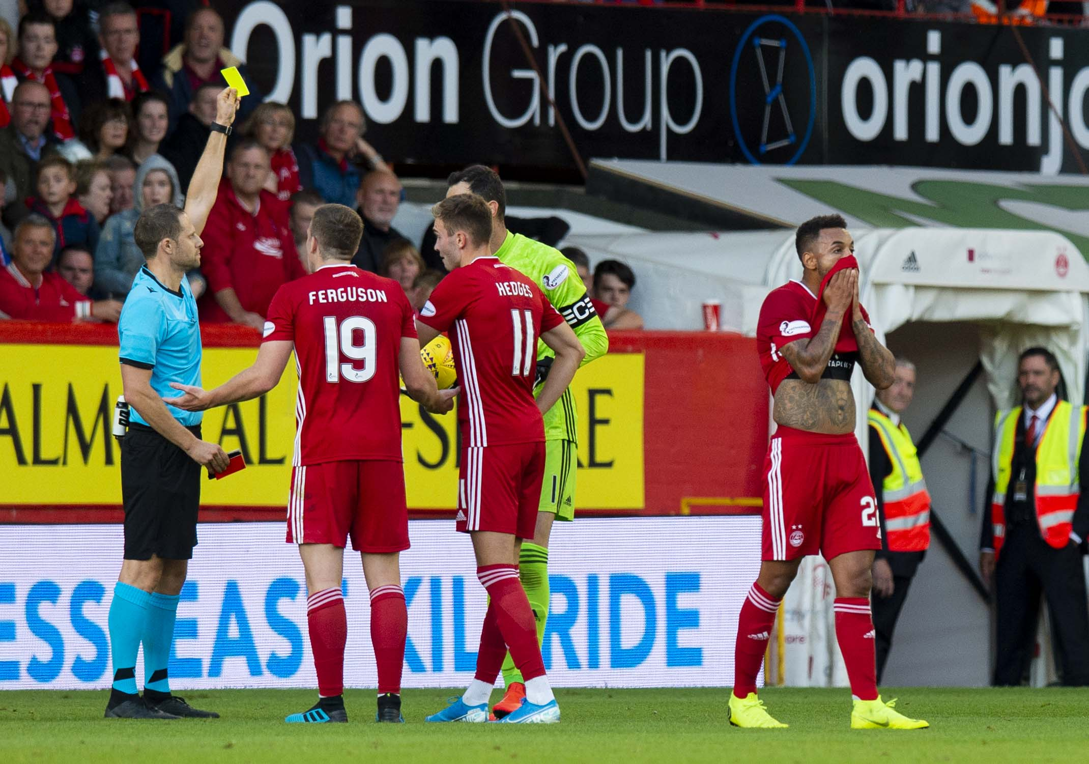 Aberdeen's Funso Ojo leaves the pitch after being red carded whilst team mate Joe Lewis is yellow carded for dissent