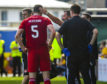 Aberdeen's Scott McKenna is forced off with a first half injury.
