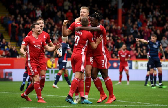 ABERDEEN, SCOTLAND - AUGUST 31: Aberdeen's Sam Cosgrove celebrates his goal during the Ladbrokes Premiership match between Aberdeen and Ross County at Pittodrie Stadium on August 31, 2019, in Aberdeen, Scotland (Photo by Craig Williamson / SNS Group)