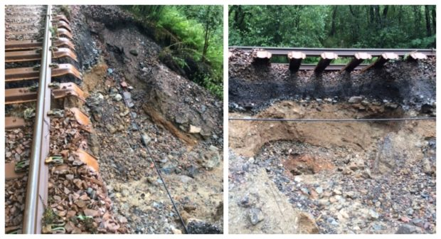The rail line has been left exposed after a landslip.