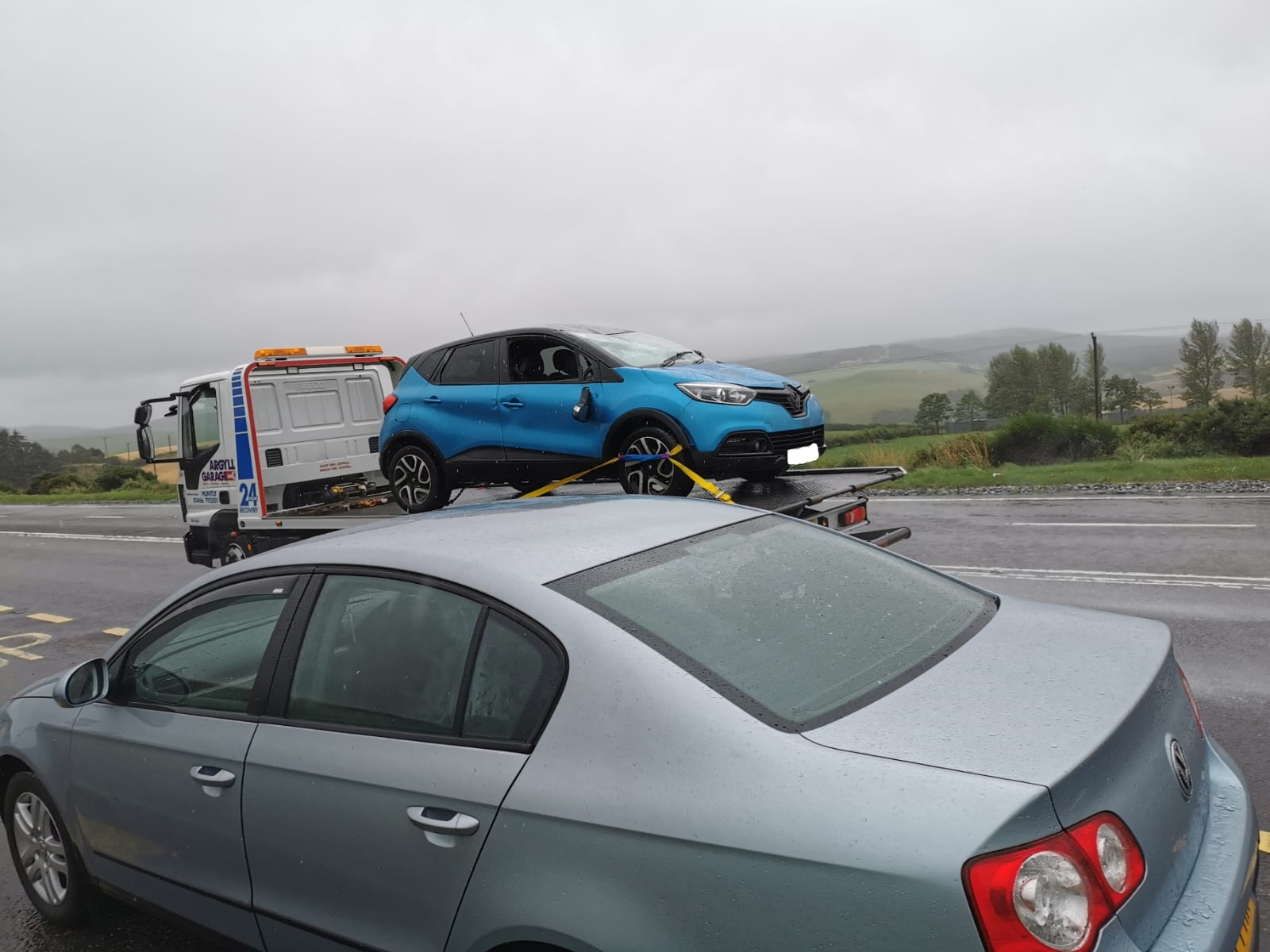The car being removed by a recovery vehicle.