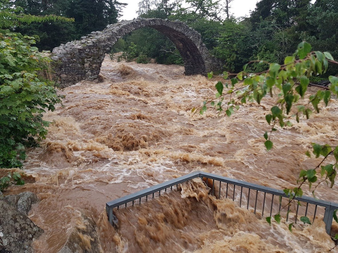 The flooding at the old packhorse bridge in Carrbridge.