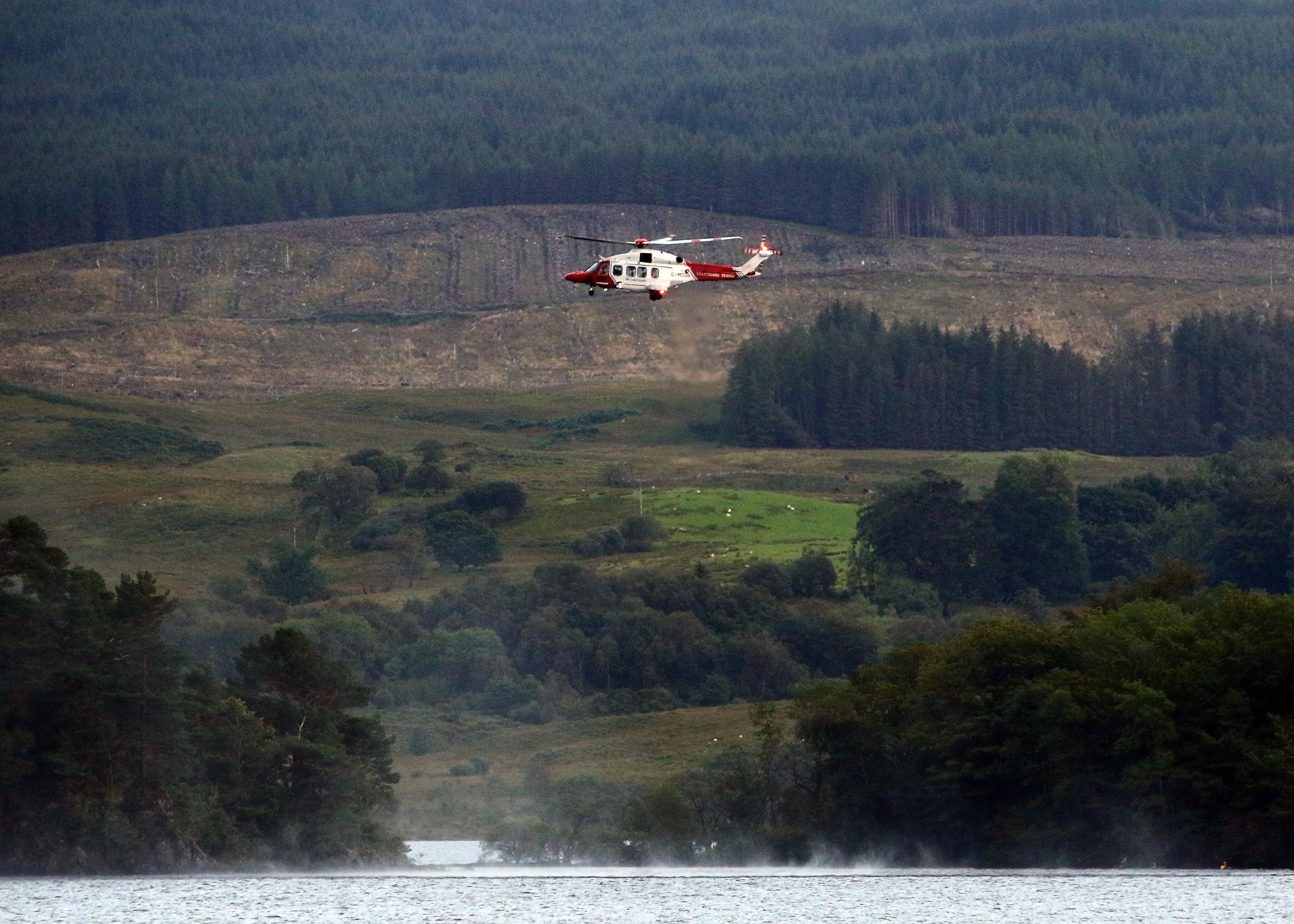 A coastguard helicopter scours Loch Awe.