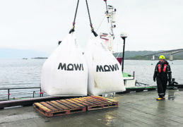 Bags of feed being loaded at Mowi's new salmon feed plant at Kyleakin on Skye