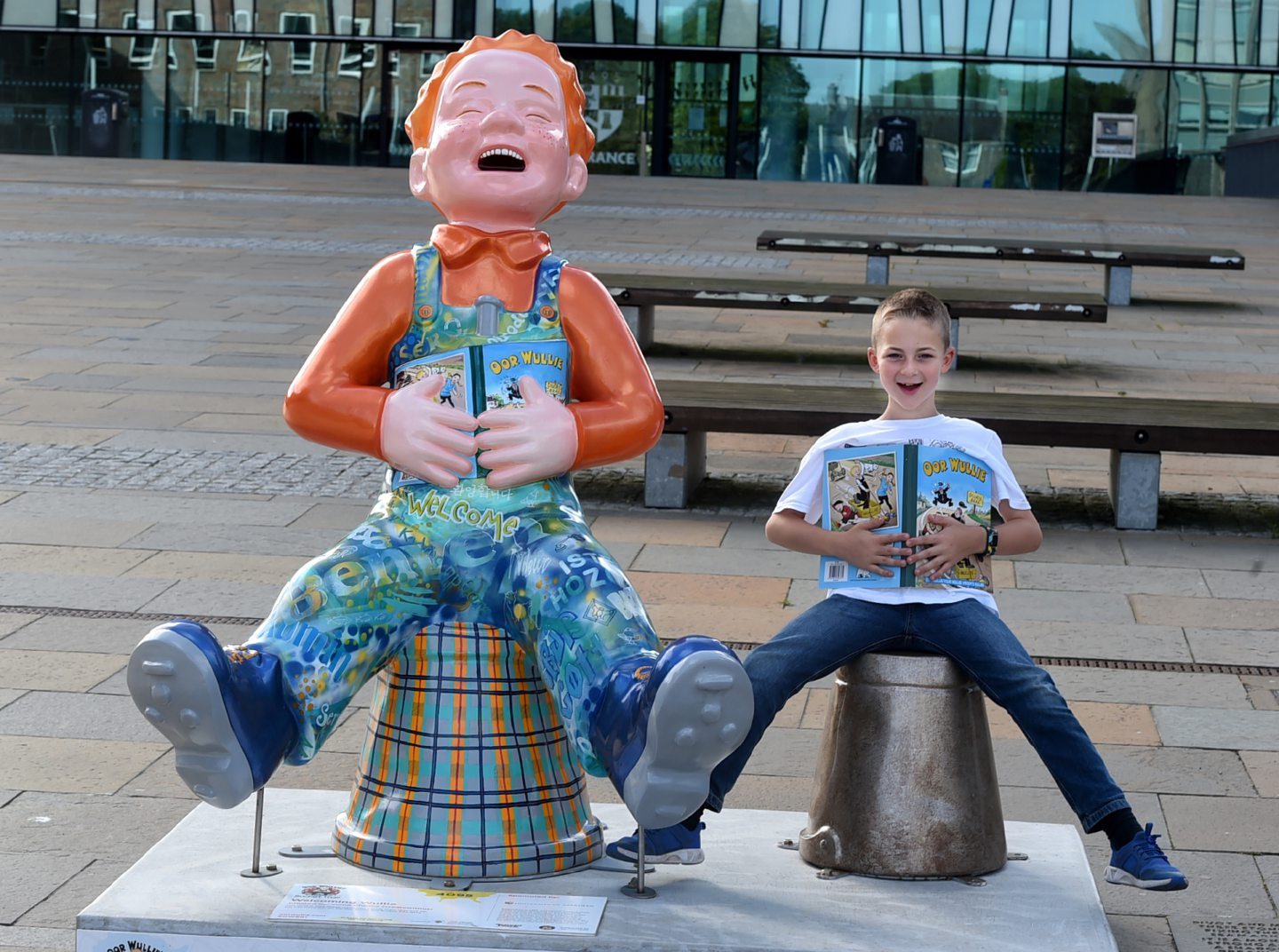 Jamie Lytham, from Mintlaw Academy has collected all 200 Oor Wullies across the country and is posing with his favourite statue at Aberdeen University. Picture by Jim Irvine