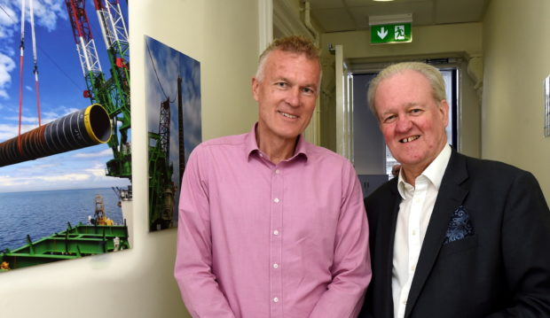 Stewart Stevenson MSP on a tour of the temporary Marine Centre for Moray East. Dalrymple Hall and Arts Centre, Fraserburgh. In the picture are from left: Marcel Sunier, project director and Stewart Stevenson MSP.  Picture by Jim Irvine  28-8-19
