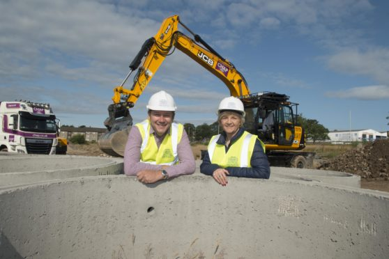 Council co-leaders Douglas Lumsden and Jenny Laing at the former Summerhill Academy site last August, as work started on 369 council houses.