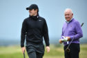 Rory McIlroy and his father, Gerry McIlroy during preview for the Alfred Dunhill Links Championship at The Old Course. (Photo by Mark Runnacles/Getty Images)