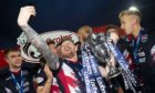 Michael Gardyne poses for a selfie with the Championship trophy in 2019.