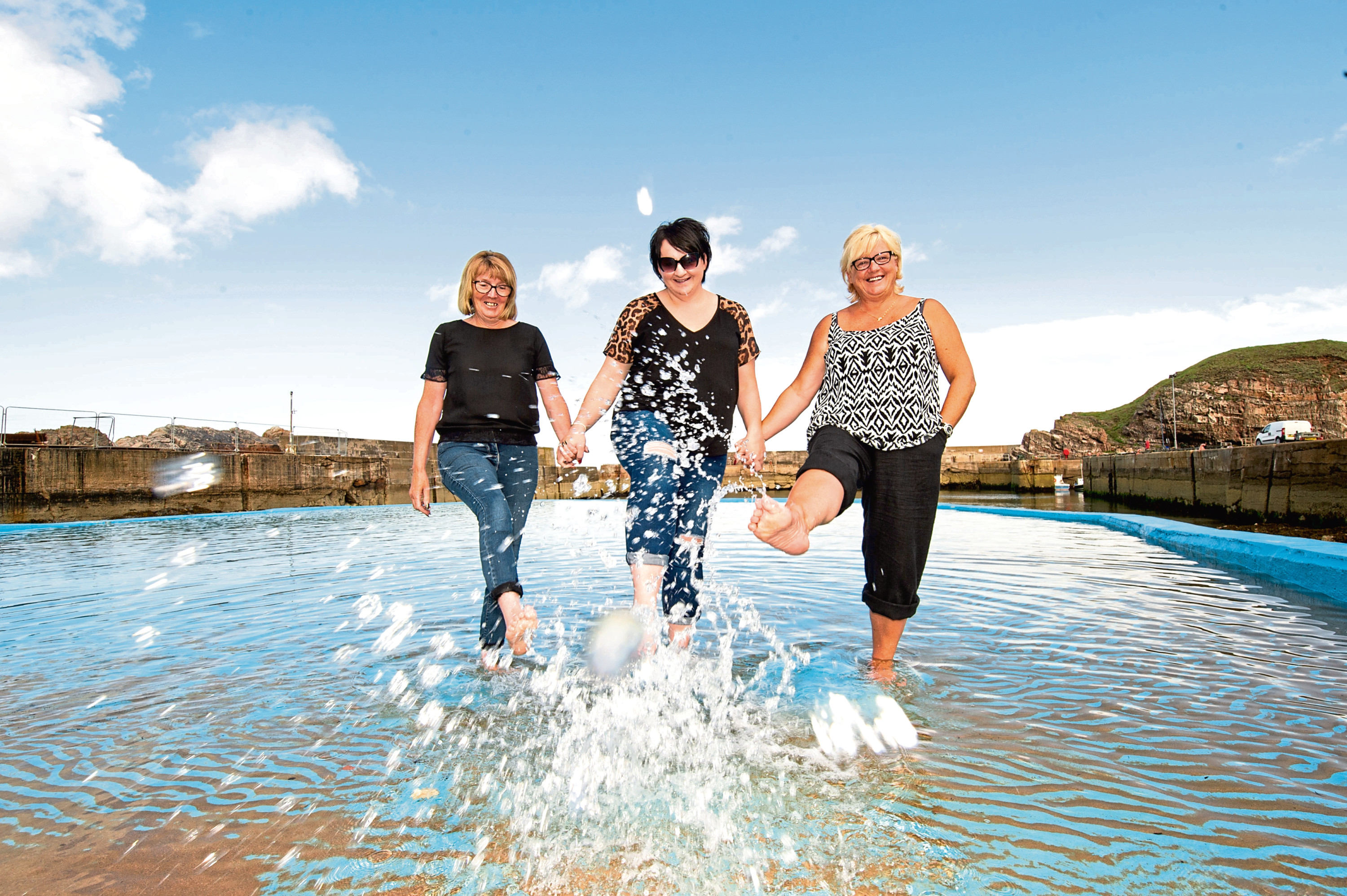 Lillian Urquhart, Kirsty Farquhar and Donna Coull at Portknockie paddling pool.  Picture by Jason Hedges