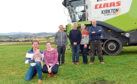 Pictured from left, Scott Campbell, three-month-old son Blair and wife Elaine, Grant Cameron, worker, Iain and Lesley Campbell and Neil Campbell.