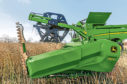 Improved crop flow from knife to auger is claimed for the lower-profile design of John Deere's 700X adjustable cutting table.