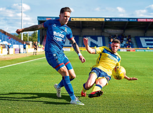 Miles Storey of Inverness and Adam Livingstone during the Tunnocks Caramel Wafer Challenge Cup 3rd Round between Inverness and Morton