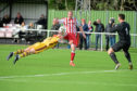 Formartine's Scott Lisle, Forres' Graham Fraser and goalie Stuart Knight.  Picture by KATH FLANNERY