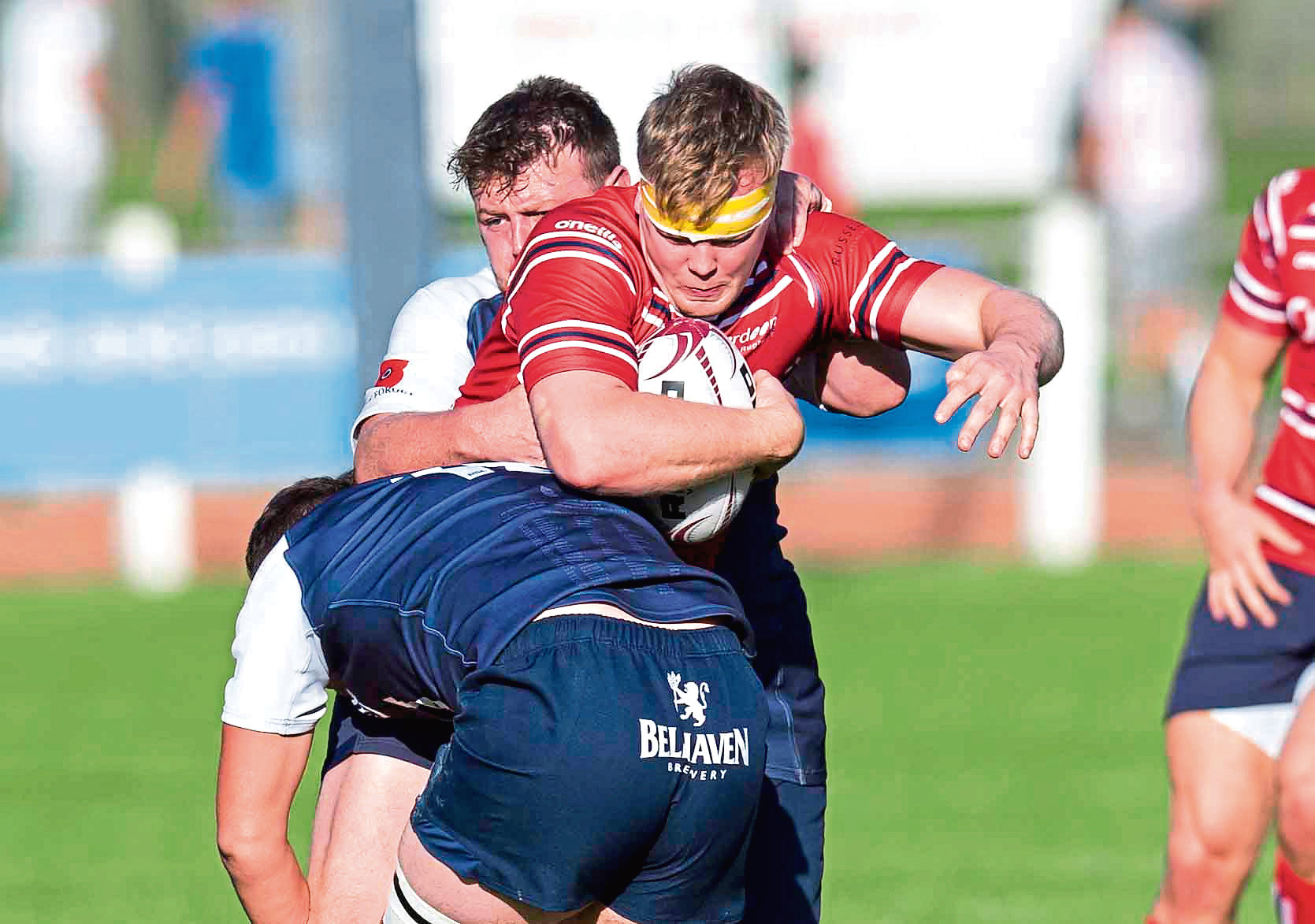 berdeen's Robin Cessford (L) in action with Selkirk's Derry Alexander during the Tennent's Premiership match between Selkirk and Aberdeen Grammar
