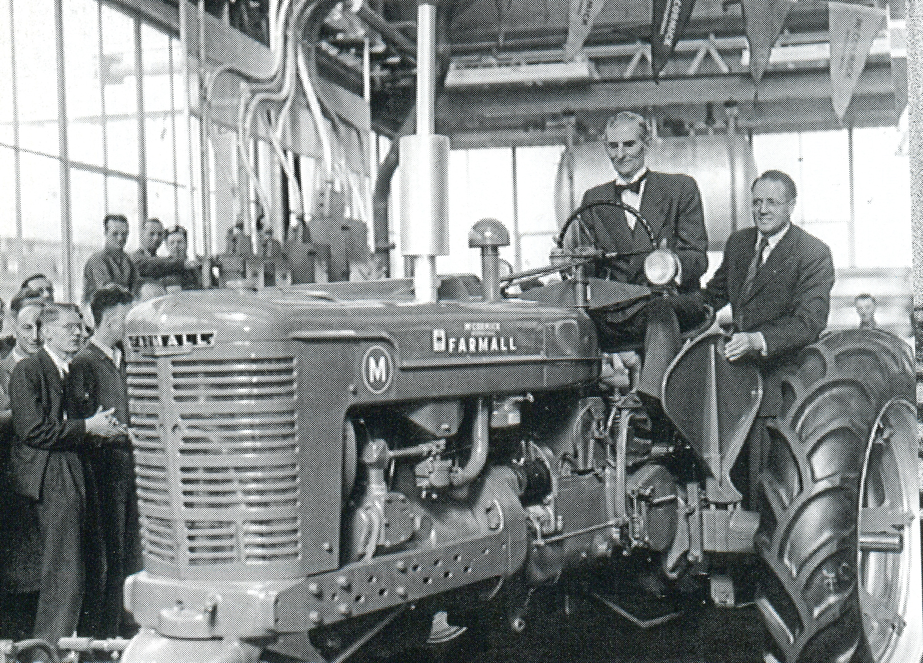 Minister of Agriculture Tom Williams with IH GB Managing Director J A Purves looking on drive the first British built Farmall M off the Doncaster line on September 13, 1949.