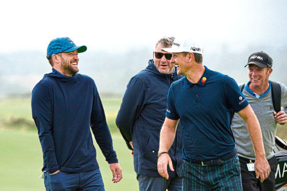 Justin Rose stands with musician, Justin Timberlake as they share a joke on the fifth green during previews for the Alfred Dunhill Links Championship at The Old Course. (Photo by Mark Runnacles/Getty Images)