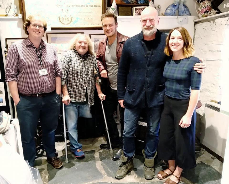 Glencoe Folk Museum volunteers with the Outlander stars PIC: Glencoe Folk Museum