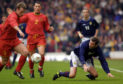 Belgium's Joos Valgaeren (left) takes the ball from Scotland's Don Hutchison during the World Cup Group Six qualifier game at Hampden Park, Glasgow on March 24, 2001. Photo: Ben Curtis