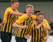 Gordon McNab celebrates with his team-mates.