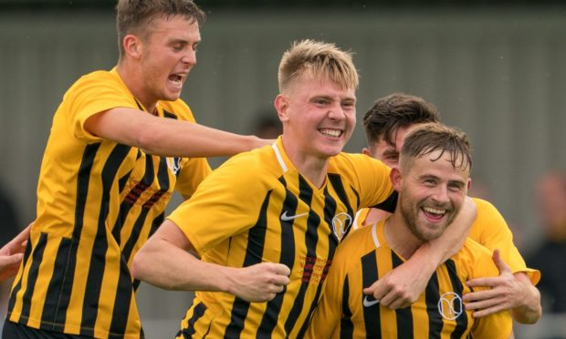 Gordy McNab, front right, celebrates with his Nairn County team-mates.