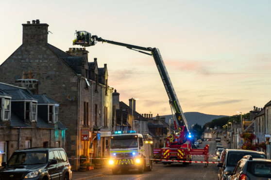 Streets were sealed off in Dufftown as fire crews tried to rescue the cat.