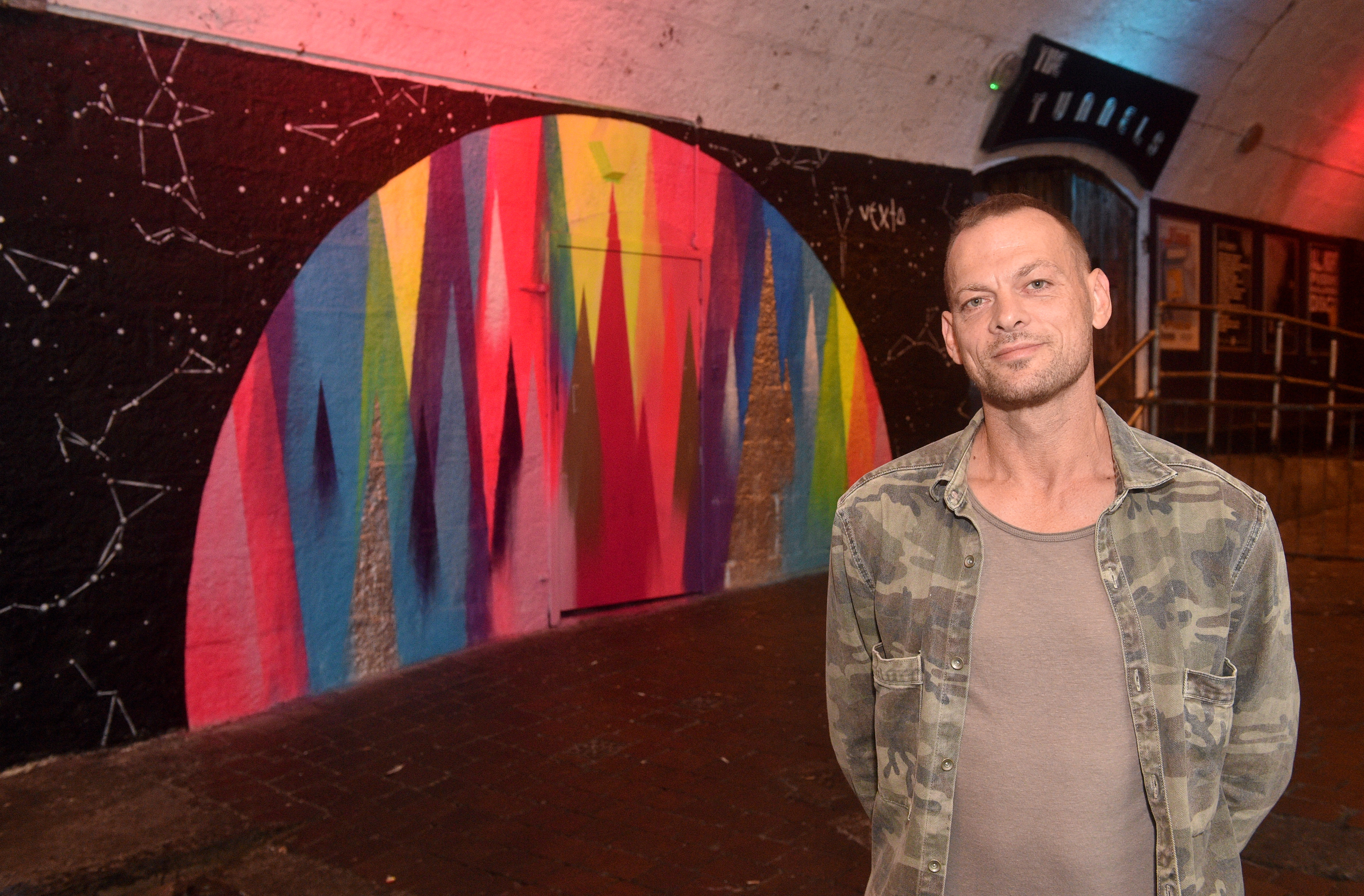 Tunnels manager Steve Morris at The Tunnels where artist Vexta has painted a mural.