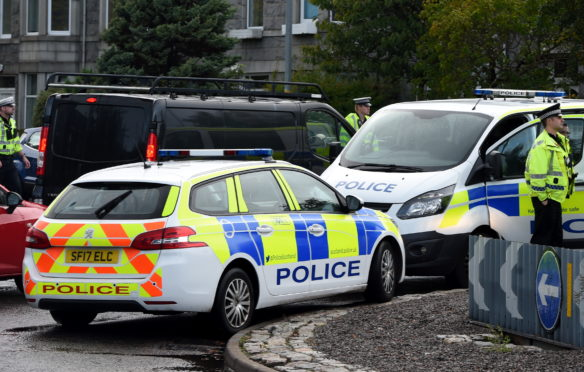 Emergency services at the scene of a crash at the Broomhill Road roundabout