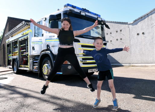 Olivia, 9 and Dexter Mitchell, 6 at Stonehaven community fire station.