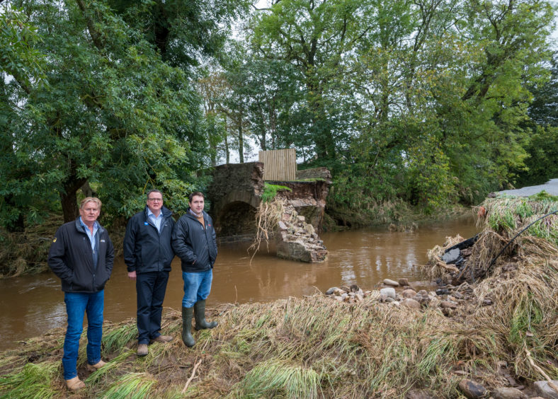 L-R: Farmers, Wilson Strachan, Philip Benzie and Charles Duguid at one of the bridges that collapsed.