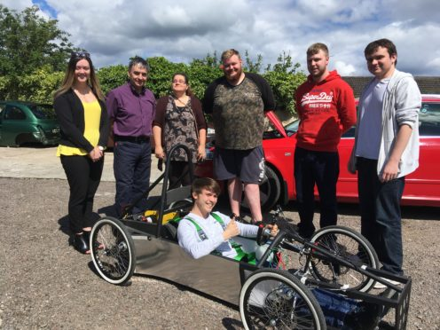 The completed car. Pictured standing: Aimee Stephen from DYW Moray, lecturer Paul Rochford and students Charlotte Usher, Morgan Brown, David Stewart, John Dalmon. Sitting: Jamie Smith.