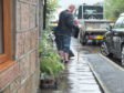 Residents used brooms to clear overflowing drains