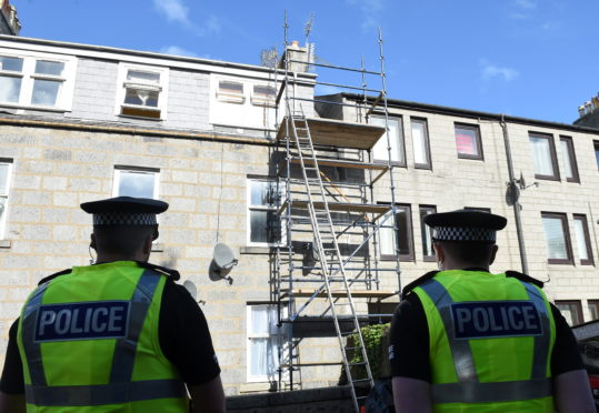 Police look at the scaffolding on Jute Street in September 2016.