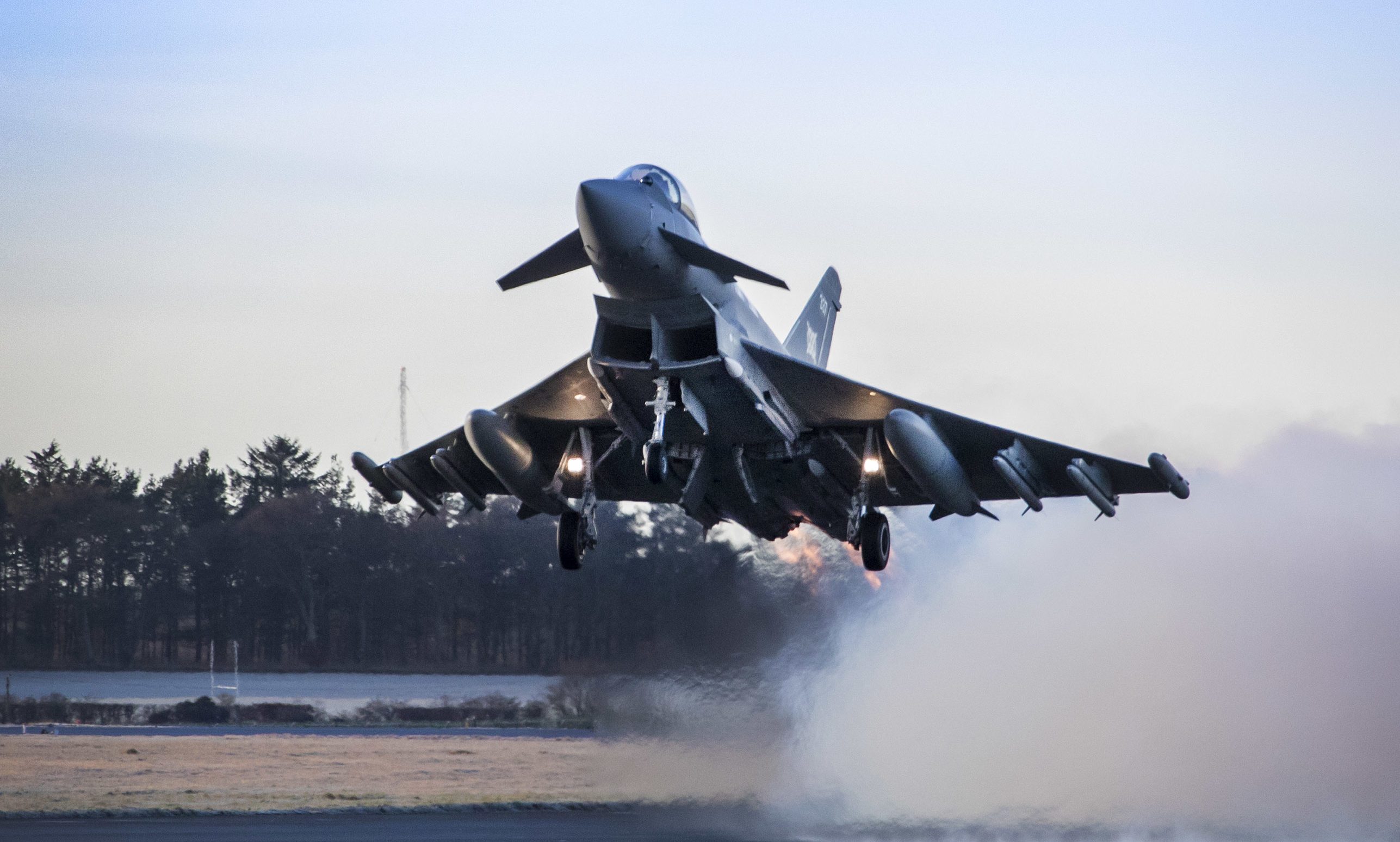 An RAF Lossiemouth Typhoon fighter jet takes off on a Quick Reacion Alert scramble.