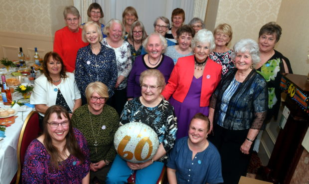 Mary Greig, centre, celebrated her 60th wedding anniversary with a hen party