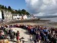 Hundreds of children sing on the beach at Tobermory