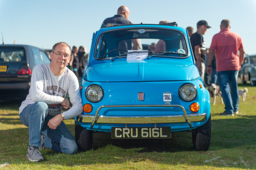 Mike Packer from Inverness is pictured with his 1972 Fiat500L. Picture by Jason Hedges.