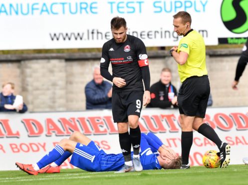REFEREE STEVEN KIRKLAND REACHES FOR THE RED CARD FOR DAVID GOODWILLIE  AFTER HIS CHALLENGE ON DAVID FERGUSON