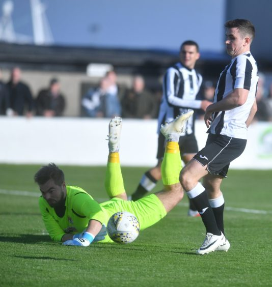 Fraserburgh's Paul Campbell and Bonnyrigg's keeper Mark Weir who saves the shot. Pic by Chris Sumner