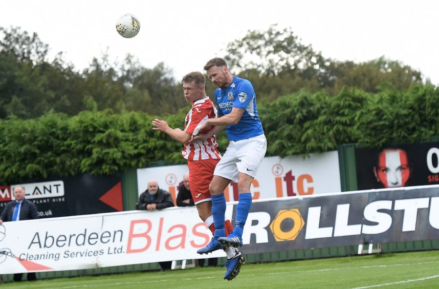 Formartine's  Kieran Lawrence and Glenavon's Andrew Hall.  Picture by HEATHER FOWLIE