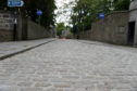 Newly repaired cobble stone road of Old Aberdeen's High Street.