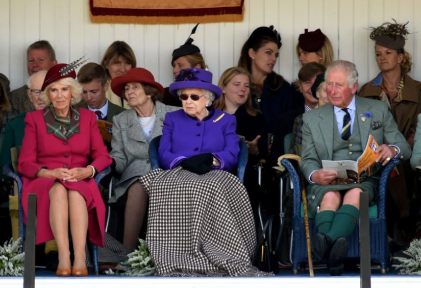 Picture of (L-R) Camilla Duchess of Rothesay, Queen and Prince Charles watching the games.  Picture by KENNY ELRICK