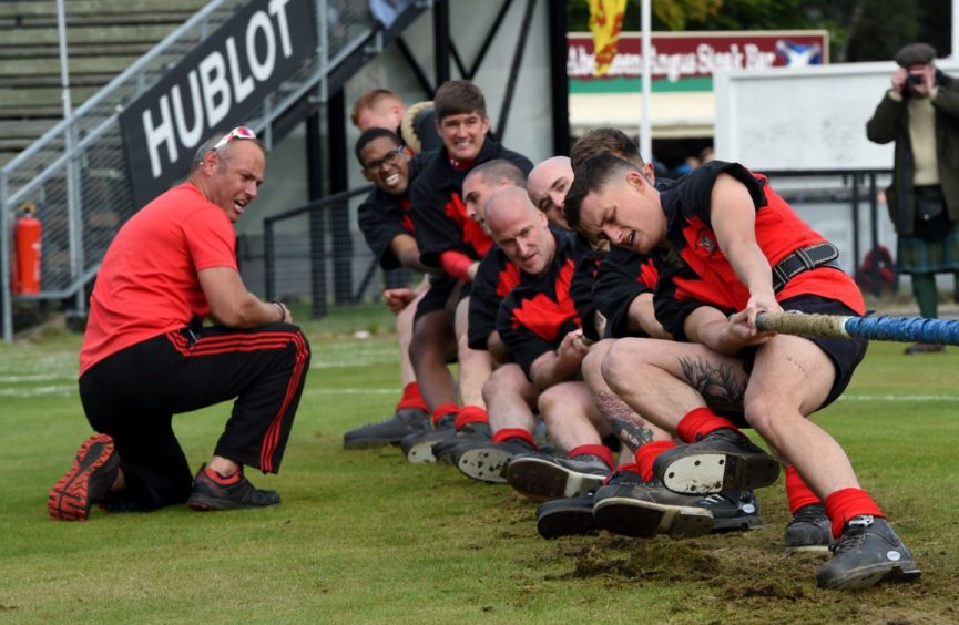 The 6th Battalion Reme during the Tug o war.  Picture by KENNY ELRICK