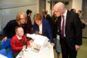 Reagan Stephen, 9, with Nicola Sturgeon and John Swinney.  Picture by KENNY ELRICK