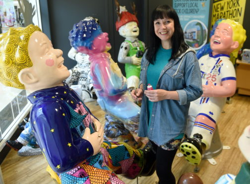 Art Director of the Oor Willie's Big Bucket Trail, Suzanne Scott in Inverness yesterday titivating the ten Inverness statues before their farewell event and auction later this month. Picture by Sandy McCook