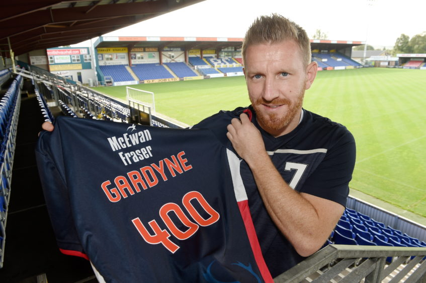 Michael Gardyne of Ross County who celebrated 400 appearances for the club on Saturday.
