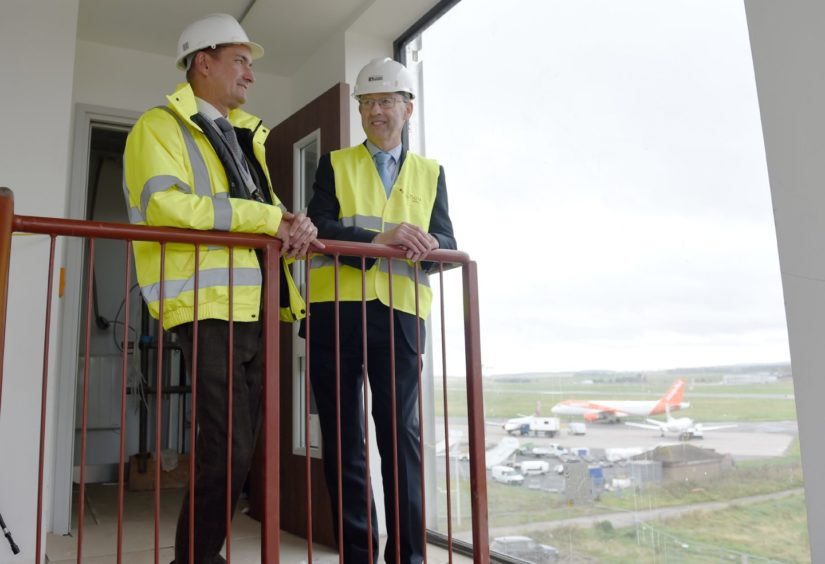 Graeme Bell, general manager of Inverness Airport and Stewart Nicol of Inverness Chamber of Commerce tour the new airport hotel. Picture by Sandy McCook.