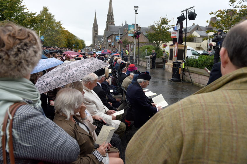 Families, friends and members of the regiment gathered to pay their respects. Picture by Sandy McCook